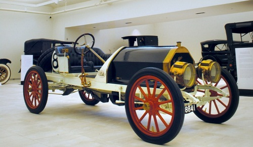 An open-air early automobile